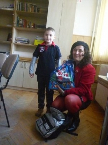 Presents for poor childrens from School Nicolae Titulescu Cluj-Napoca with Christmas ocassion